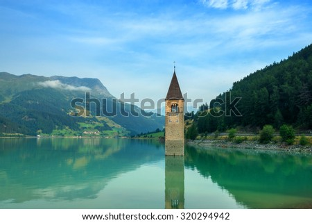 Beautiful view of the lake Resia. Famous tower in the water. Alps, Italy, Europe. - stock photo