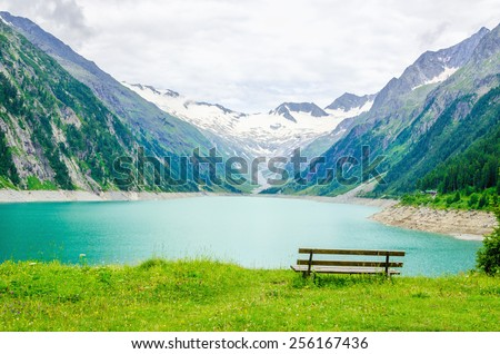Beautiful view of the lake Schlegeis and empty desk, Zillertal Alps, Austria - stock photo