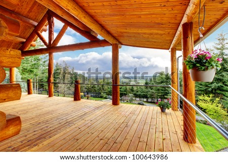 Beautiful view of the log cabin house porch of green valley. - stock photo