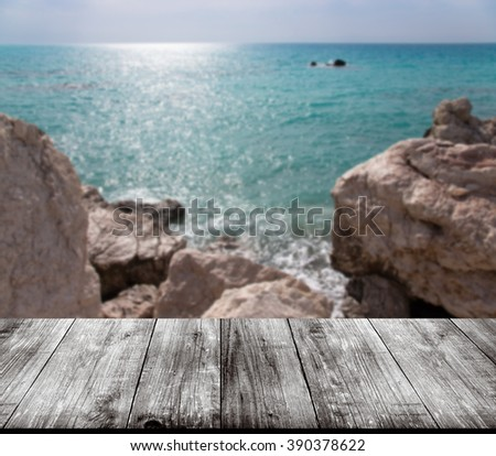 Beautiful view of the Mediterranean Sea over old light wooden table or board. Collage. Selective Focus. - stock photo