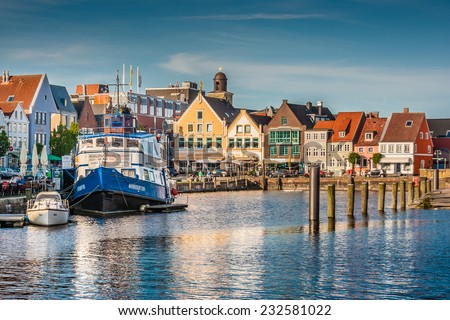 Beautiful view of the old town of Husum, the capital of Nordfriesland and birthplace of German writer Theodor Storm, in Schleswig-Holstein, Germany - stock photo