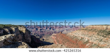 Beautiful view of the Ooh Aah tourist destination point with deep blue sky in the Grand Canyon, USA - stock photo