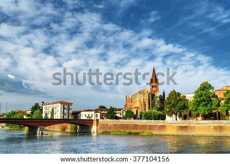 Beautiful view of the Ponte Navi over the Adige River and the Saints Fermo and Rustico church in Verona, Italy. Verona is a popular tourist destination of Europe. - stock photo