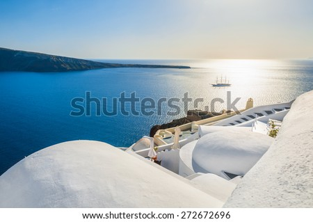 Beautiful view of the sea and islands at sunset. Oia town, Santorini island, Greece. - stock photo