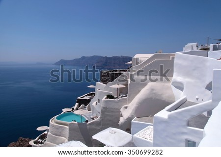 Beautiful view of the sea and white traditional terraced houses and resorts, Oia town, Santorini island, Greece.