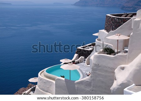 Beautiful view of the sea and white traditional terraced houses and resorts, Oia town, Santorini island, Greece. - stock photo
