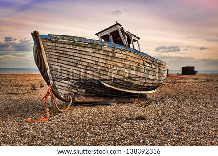 Beautiful view of the sea rocky beach with old boat reel,H D R - stock photo