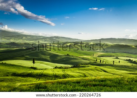 Beautiful view of the sunset over the valley in Tuscany - stock photo