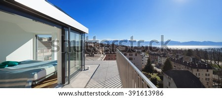 beautiful view of the Swiss Alps, by a terrace of a duplex - stock photo