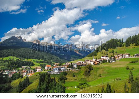 Beautiful view of the town of Moena in the Dolomite mountains, Italy - stock photo
