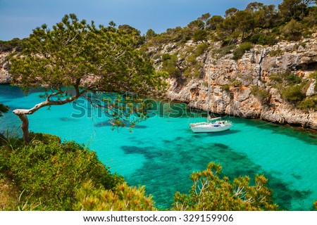 beautiful view of the yacht in azure sea in the village Cala Pi, Majorca, Spain - stock photo