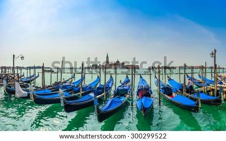 Beautiful view of traditional Gondolas on Canal Grande with San Giorgio Maggiore church in the background at morning, San Marco, Venice, Italy - stock photo