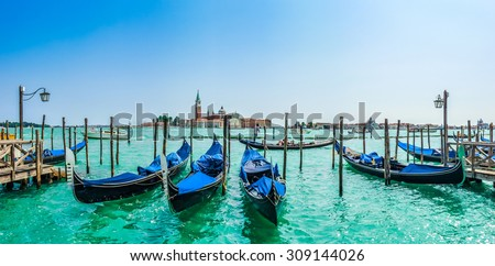 Beautiful view of traditional Gondolas on Canal Grande with San Giorgio Maggiore church in the background, San Marco, Venice, Italy - stock photo