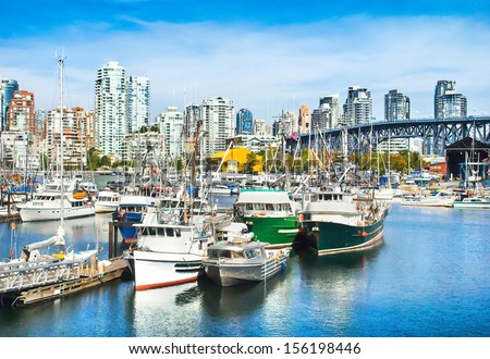 Beautiful view of Vancouver skyline with Granville bridge and ships lying in harbor at False Creek, British Columbia, Canada - stock photo