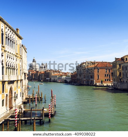 beautiful view of Venice Grand Canal. sunny day landscape with historical houses, traditional Gondola boats and colorful buildings. Italy voyage destination scenic. famous European Union places - stock photo