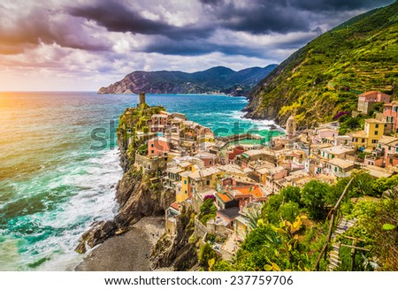 Beautiful view of Vernazza, one of the five famous fisherman villages of Cinque Terre with dramatic cloudscape at sunset in Liguria, Italy - stock photo
