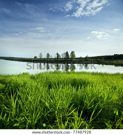 beautiful view of  water grass and sky poland - stock photo