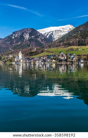 Beautiful View Of Wolfgang Lake With St. Wolfgang Im Salzkammergut And Grosser Hollkogel In The Background And Their Reflection On The Water-Salzkammergut, Austria,Europe