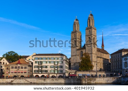 Beautiful view of Zurich old town with Grossmunster Church and Limmat river at dusk, Zurich, Switzerland.