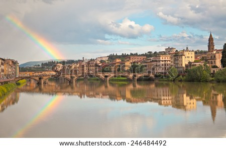 Beautiful view on Florence river Arno and rainbow. - stock photo