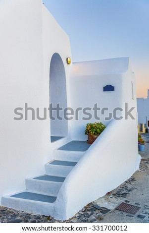 Beautiful view on greek traditional white stone house at Oia village in sunset time.Santorini (Thira) island.Cyclades.Greece.Europe - stock photo