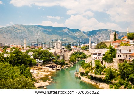 Beautiful view on Mostar city with old bridge, mosque and ancient buildings on Neretva river in Bosnia and Herzegovina - stock photo