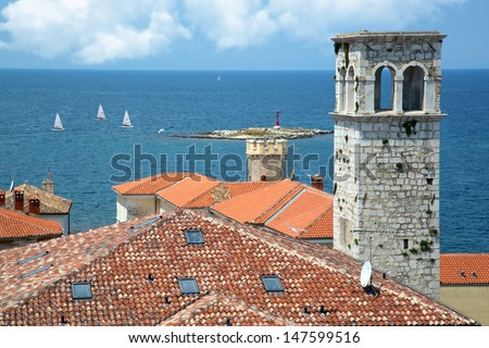 Beautiful view over the roofs of sailing in the sea - stock photo