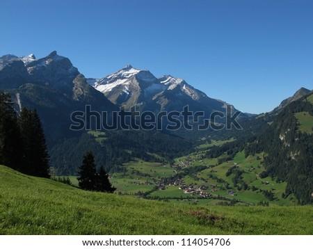 Beautiful Village Named Gsteig Bei Gstaad, Swiss Alps - stock photo
