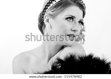 beautiful vintage blonde woman with a boudoir fan