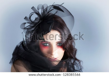 Beautiful Vintage Carnival Girl In Spring Style Make-Up And Fascinator In A Depiction Of Fashions Of The Field - stock photo