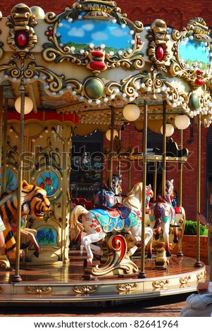 beautiful vintage merry-go-round with horses  and other animals for kids - stock photo