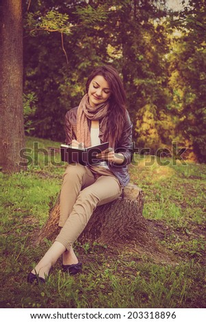 beautiful vintage portrait of a girl book - stock photo