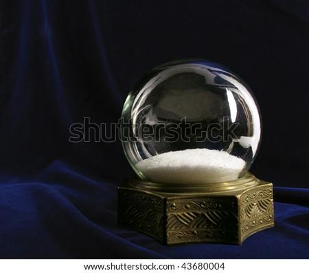 Beautiful vintage snow globe on deep blue velvet - stock photo