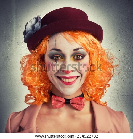 Beautiful vintage woman clown smiling and extravagant - stock photo