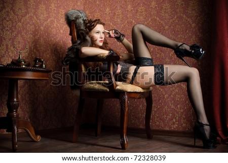 beautiful vintage woman posing in studio - stock photo