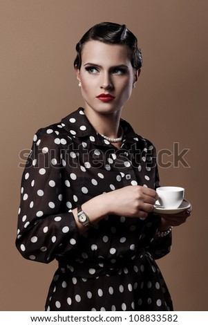 Beautiful vintage woman with cup of coffee - stock photo