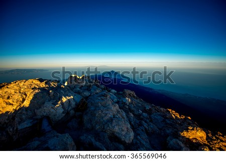 Beautiful volcanic landscape with big volcano shadow on the ocean in national park of Teide on Tenerife island. Top view on the sunset - stock photo