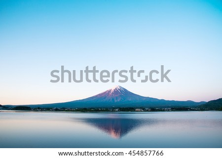 Beautiful volcano Fuji San with snow and reflection on Kawaguchiko Lake in the morning, Yamanashi, Japan. - stock photo