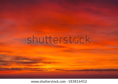 Beautiful, warm, bright colors of sunrise. In the mountains, stands a fine mist and fresh air. Cloudy sky illuminated by the sun.  - stock photo