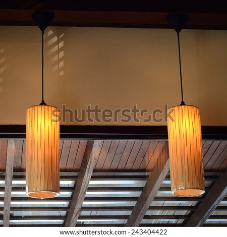 Beautiful warm lamps against interia design in a coffee shop - stock photo