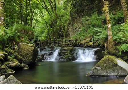 Beautiful water cascade in Killarney park - stock photo