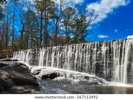 Beautiful water fall on a sunny summer day - stock photo