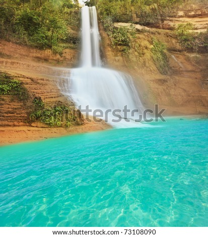 Beautiful waterfall at summer sunny day. Philippines - stock photo