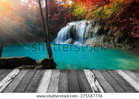 Beautiful waterfall in deep forest and wood pier at Kanchanaburi, Thailand - stock photo
