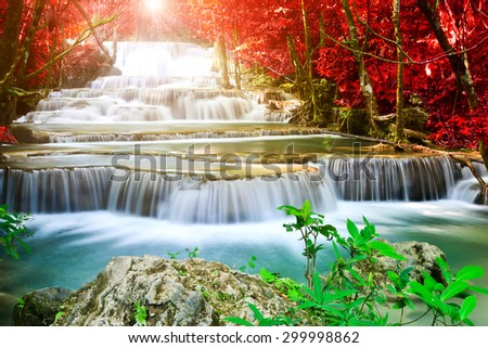 Beautiful waterfall in deep forest with sunlight  - stock photo