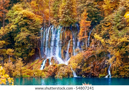 beautiful waterfall in forest, autumn - stock photo