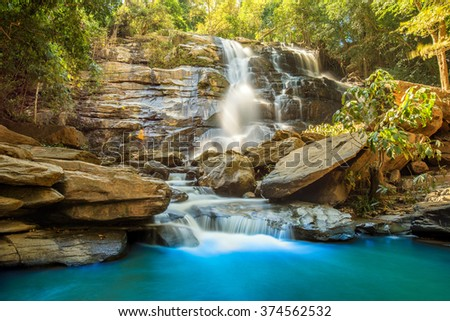 beautiful waterfall in green forest in jungle Chiang mai , Thailand - stock photo