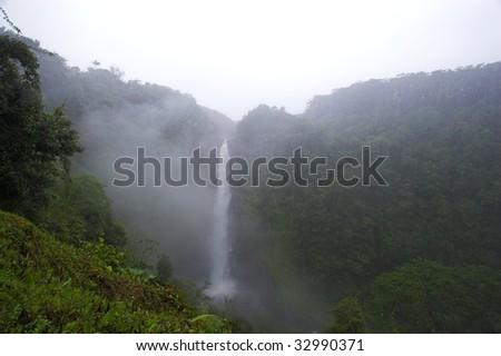 Beautiful waterfall in lush tropical Hawaii forest - stock photo