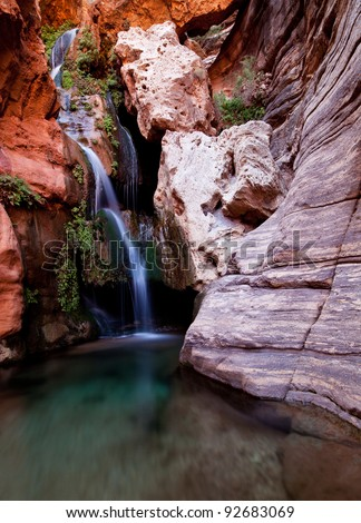 Beautiful waterfall in one of the side canyons along the Colorado River in the Grand Canyon - stock photo