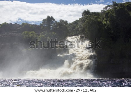 Beautiful Waterfall in the Canaima Lagoon, Canaima National Park, Venezuela, South America 2015 - stock photo